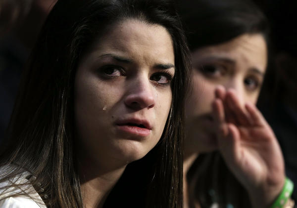 "Sisters of Sandy Hook Elementary shooting victim first-grade teacher Victoria Soto, Jillian Soto, right, and Carlee Soto, left, listen during a hearing before the Senate Judiciary Committee February 27, 2013 on Capitol Hill in Washington, DC. The committee held a hearing on ""The Assault Weapons Ban of 2013."""
