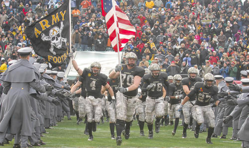 The Army football team runs onto the field at Lincoln Financial Field in Philadelphia prior to the 109th meeting against Navy.