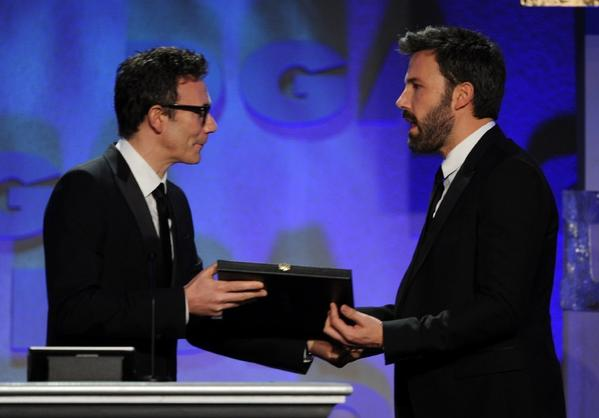 "Michel Hazanavicius, left, presents Ben Affleck with the award for achievement in feature film for ""Argo"" at the 2013 Directors Guild of America Awards on Feb. 2."