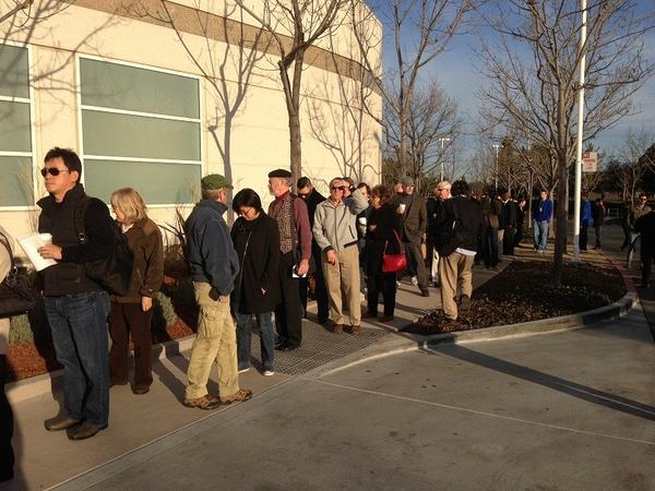 Apple shareholders wait in line before the start of the company's annual meeting at its Cupertino, Calif., headquarters.