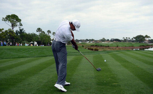 Tiger Woods plays a shot during the pro am of the Honda Classic at PGA National on February 27, 2013 in Palm Beach Gardens, Florida.