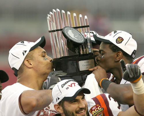 Defensive end Orion Martin (90) and split end Cory Holt (12) of the Virginia Tech Hokies kiss the ACC trophy after defeating the Boston College Eagles in the 2008 ACC Football Championship game at the Raymond James Stadium in Tampa. Virginia Tech defeated Boston College 30-12.