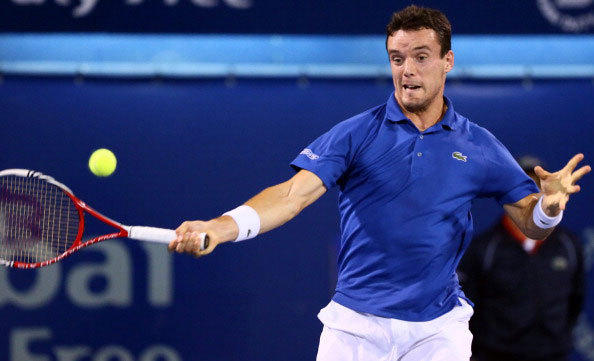 Spain's Roberto Bautista Agut hits a return to Serbia's Novak Djokovic during their ATP Dubai Open tennis match in the Gulf emirate on February 27, 2013.