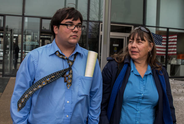 Matthew Herrmann, 19, and his mother, Cindy, leave the Leighton Criminal Court Building after sentencing hearing today. Herrmann was sentenced to two years of probation. Herrmann, of Alsip, was charged with committing a hate crime against a black teen.