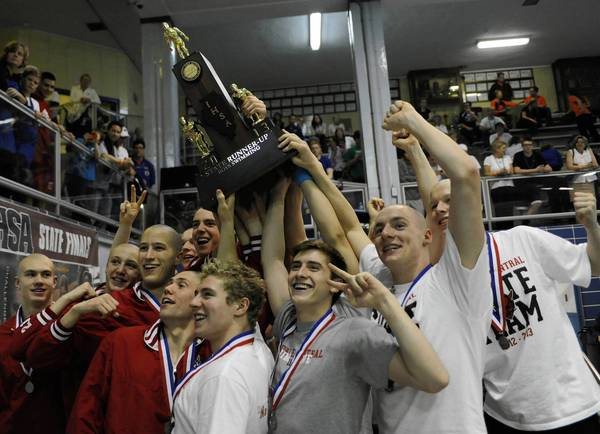 The Hinsdale Central swim team holds the second place trophy after the boys state swimming and diving finals at New Trier in Winnetka Saturday, Feb. 23.