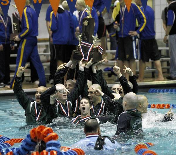 New Trier swimmers celebrate with fist place tiotle with the IHSA trophy at the IHSA Boys State Swimming Finals at Evanston high school at 1600 Dodge Avenue, in Evanston on Saturday, Feb. 25.