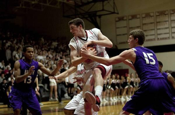 Maine South senior Danny Quinn, 22, grabs a rebound during the third quarter at Maine South High School on Feb. 20.