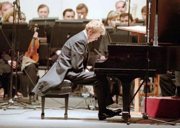 "Van Cliburn pauses before performing an ""encore"" piece during an appearance at the Hollywood Bowl."