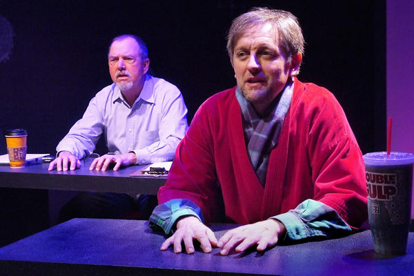 "FBI agent Richard Roe (Gregory Itzin, left,) and possible sexual predator John Doe (JD Cullum) burn the midnight electricity in Doris Baizley's play ""SexSting."""