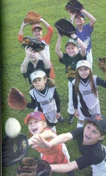 Local youths were gearing up for the 2003 La Cañada Junior Baseball and Softball Assn. season. Left row, front to back: Kaitlin Powers, Annie Monroe, Kyle Van Der Linde and Tara Rallis. Right row, front to back: Jeff Lee, Drew Donaldson, Chad Powers and Cole Kendall.