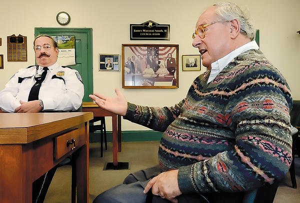 Mercersburg, Pa., Mayor James C. Zeger, right, talks about the borough's police department as Police Chief John D. Zechman listens in.