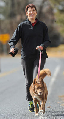 Michelle Lorah of Topton is out for a 6-mile run on Old Topton Road with her mixed Australian Shepherd Wylie E after the rain stopped Wednesday afternoon.