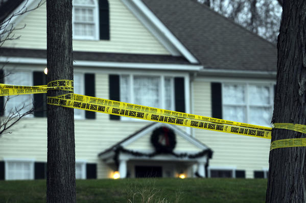 Police tape surrounds the home of Nancy and Adam Lanza at 36 Yogananda St. in Newtown on Dec. 20.