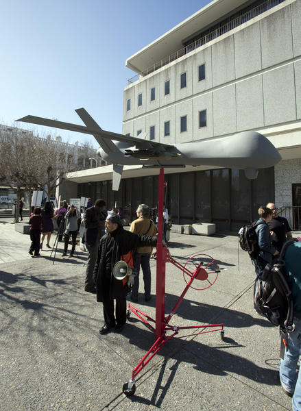 A model of a military-style drone stands outside the Alameda County Administration Building earlier this month before the start of a hearing on the Alameda County Sheriff's plan to acquire a drone for aerial enforcement.