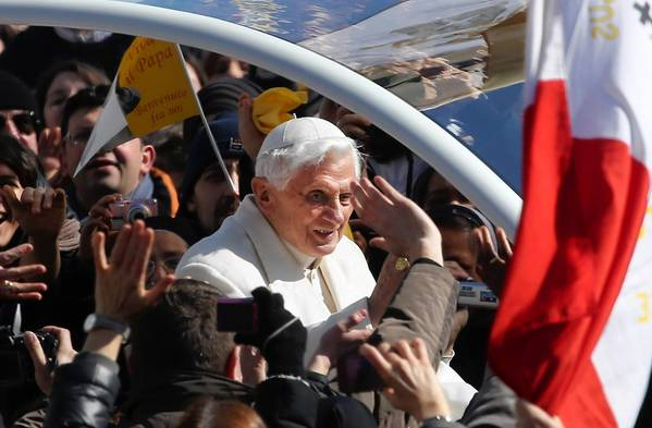 Pope Benedict XVI arrives in St. Peter's Square for his final general audience. More than 100,000 thronged the square.