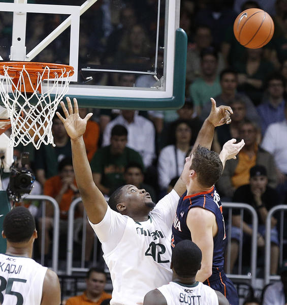 Second-ranked Miami-Florida escaped with another hard-fought ACC victory on Tuesday. Reggie Johnson's layup with 5.7 seconds remaining lifted the Hurricanes over the Virginia Cavaliers, 54-50. It was the 14th consecutive victory for Miami (22-3, 13-0 ACC), which survived a thriller on Sunday night, overcoming a late four-point deficit to down Clemson, 45-43. Johnson ended with eight points and seven rebounds for the Hurricanes, who are off to the best start in conference history since Duke went 16-0 en route to the league crown in the 1998-99 season. Shane Larkin and Rion Brown added 11 and 10 points, respectively, for the winners.