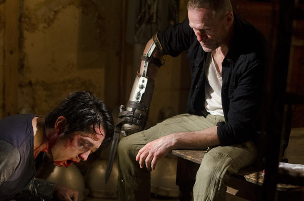 "Glenn (Steven Yeun) and Merle Dixon (Michael Rooker) in a scene from the third season of ""The Walking Dead."""