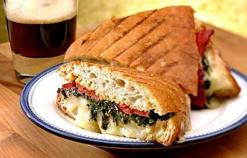 Green panini with roasted peppers and Gruyere cheese.