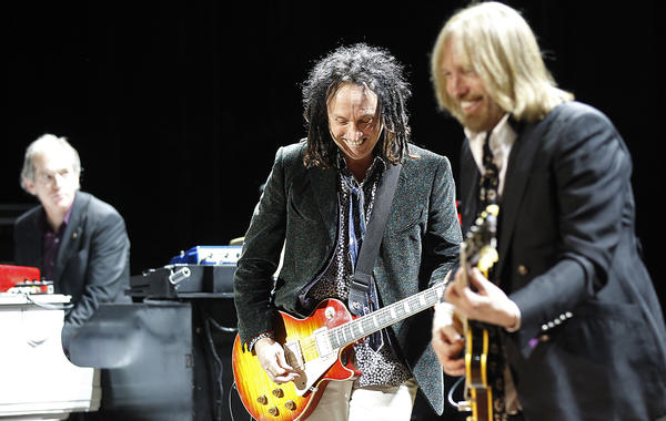 Tom Petty, right, and Heartbreakers Benmont Tench, left, and Mike Campbell, shown at a 2011 benefit in Northridge, will play six nights at the Fonda Theatre in Hollywood in June.