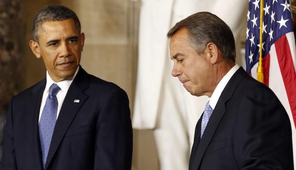 President Obama looks over as House Speaker John Boehner during the unveiling ceremony for the Rosa Parks statue in the U.S. Capitol on Wednesday.