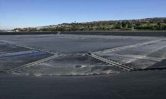 A large rubber cover protects the city of Newport Beach's largest reservoir, which holds 195 million gallons of water. The City Council voted for a contract to replace the torn and deteriorating cover.