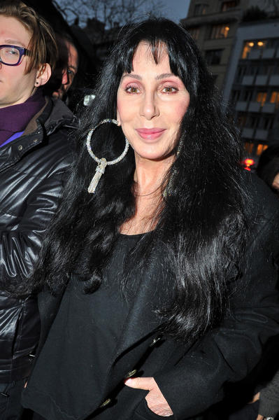 Singer/actress Cher leaves British fashion designer Gareth Pugh's fall-winter fashion presentation Wednesday in Paris.