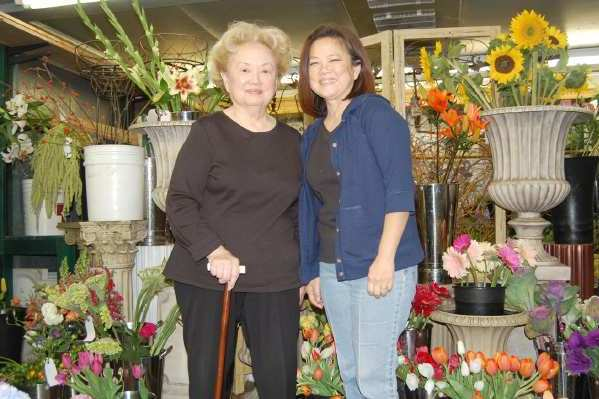 ARCHIVE PHOTO: Hannah, left, and Lisa Tomita of Eiji's Florist have provided flower arrangements for thousands of events throughout southern California. Community members attended a memorial service for Hannah Tomita on Saturday, Feb. 23.