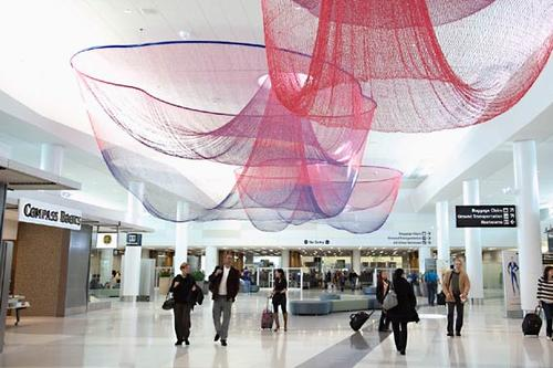 "Janet Echelman's sculptural work, ""Every Beating Second,"" hangs over the ""recomposure"" area of Terminal 2. The area is designed to give travelers a comfortable place to compose themselves after passing through TSA security checkpoints."