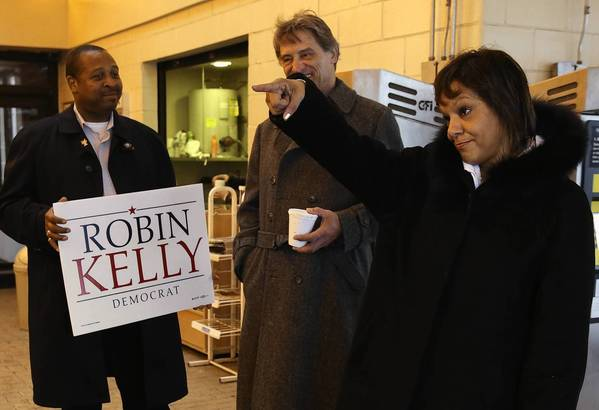 Second Congressional District Democratic nominee Robin Kelly greets voters at the Richton Park Metra station Wednesday.
