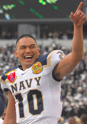 Quarterback Kaipo-Noa Kaheaku-Enhada acknowledges the crowd as the clock winds down in Navy's 34-0 victory over Army.