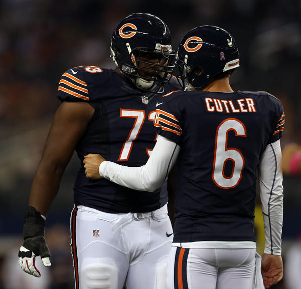 Bears QB Jay Cutler talks with J'Marcus Webb after Cutler's 4th quarter TD pass to Brandon Marshall during the Bears' 34-18 win over  the Cowboys.
