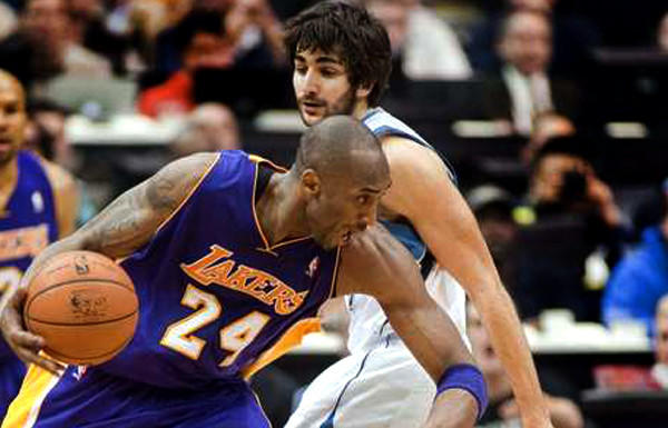 Lakers guard Kobe Bryant drives against Wolves guard Ricky Rubio during a game last season.
