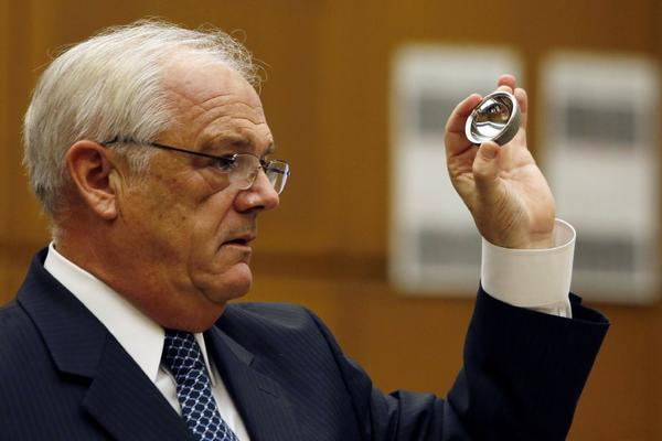 Michael Kelly, an attorney for patient Loren Kransky, holds up an ASR hip implant during a state court trial in Los Angeles involving healthcare giant Johnson & Johnson.