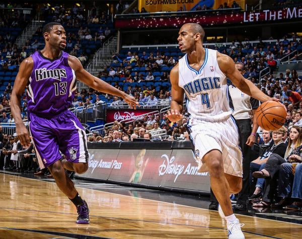 Magic guard Arron Afflalo (4) drives past Sacramento's Tyreke Evans (13) during first quarter action of a game against the Sacramento Kings at Amway Center in Orlando, Fla. on Wednesday, February 27, 2013. (Joshua C. Cruey/Orlando Sentinel)