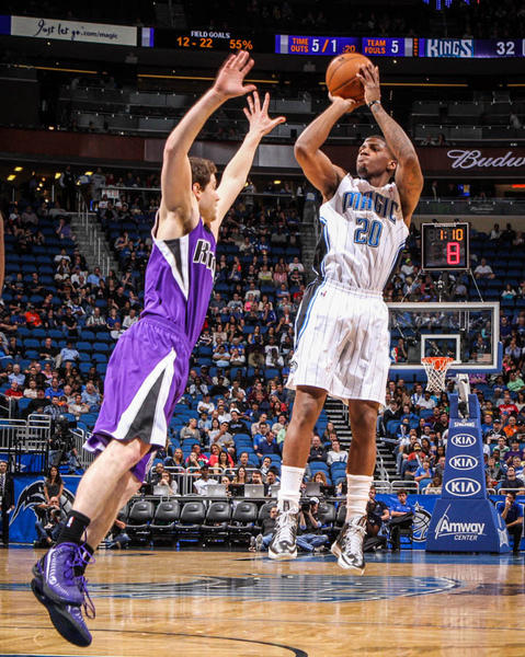 Magic forward DeQuan Jones (20) shoots over Sacramento's Jimmer Fredette (7) during first quarter action of a game against the Sacramento Kings at Amway Center in Orlando, Fla. on Wednesday, February 27, 2013. (Joshua C. Cruey/Orlando Sentinel)