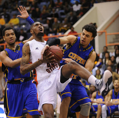 Coppin State's Zachary Burnham, right, strips the ball away from Morgan State's Shaquille Duncan, center, as the Eagles' Patrick Cole also defends.