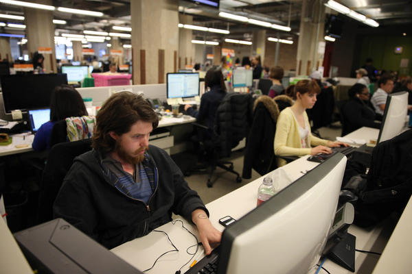 Employees work at Groupon headquarters in Chicago.
