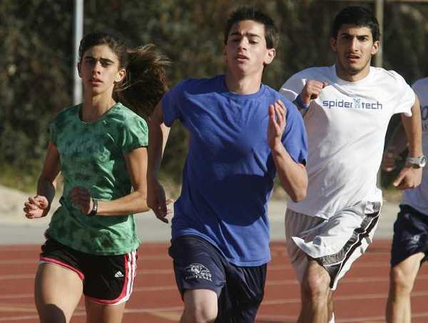 Kayleigh Carrillo, on the outside left, works with her team on sprint conditioning drills at Crescenta Valley High.