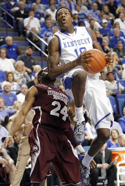 Kentucky's Archie Goodwin goes to the basket in fornt of Mississippi State's Tyson Cunningham during the first half of an NCAA college basketball game at Rupp Arena in Lexington, Ky., Wednesday, Feb. 27, 2013. (AP Photo/James Crisp)