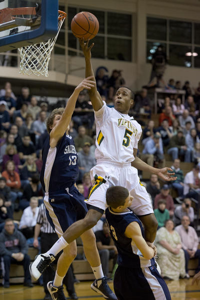 Allentown Central Catholic HIgh School's Muhammed-Ali Abdur-Rahkman (right) puts up a basket as he is guarded by Salisbury's Dan Reichenbach (left) during District 11 AAA boys basketball semifinal game at Allen High School on Tuesday.