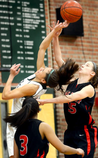 South Hagerstown's Katrice Dickson, left, fights for a rebound with Linganore's Jesse Burke, right, in the first half Wednesday night.
