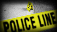 A man was shot in the leg as he struggled with a robber a block from the 911 call center on the West Side, police said.