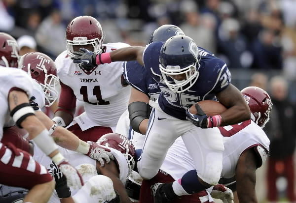 UConn running back Martin Hyppolite carries the ball during an October game against Temple.