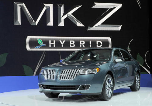 """The 2011 Lincoln MKZ Hybrid costs $34,330 — the same as the standard MKZ. That is important because """"there is somebody in the marketplace saying you don't have to pay more for a hybrid,"""" said James Bell, executive market analyst with Kelley Blue Book.<br> <br> The Lincoln MKZ Hybrid is rated at 41 mpg city and 36 mpg highway. Opt for the standard, front-wheel-drive MKZ, and the mileage estimate is 18 mpg city and 27 mpg highway."""