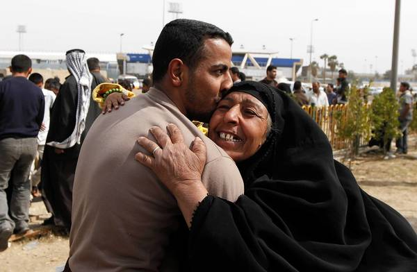 A freed detainee greets his mother outside al-Rusafa prison in Baghdad after the Iraq government released more than 160 prisoners held under anti-terrorism laws. The release was a goodwill gesture to appease Sunni Muslim demonstrators staging protests against Shi'ite Prime Minister Nuri al-Maliki. Two months of demonstrations, mainly in Sunni-dominated Anbar province, have evolved into a tough challenge for the Shi'ite premier, increasing worries that could slide back into the sectarian confrontation of its recent past.