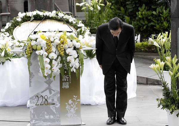 Taiwan President Ma Ying-jeou bows during a memorial for the 66th anniversary of the 228 Incident in Taipei. The 228 Incident on February 28, 1947, was a military crackdown that took place against dissidents protesting at the administration of Chen Yi, a governor appointed by Chiang Kai-shek's Chinese Nationalist Party (KMT) to help rebuild Taiwan after World War II.
