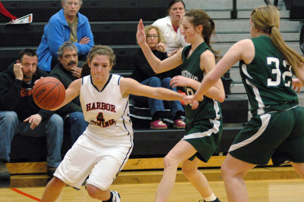 Harbor Springs junior guard Maddy Savard (left) looks to drive during Wednesday's Class C district contest against Manistique at the Harbor Springs High School gym. The Emeralds defeated the Rams, 51-32.