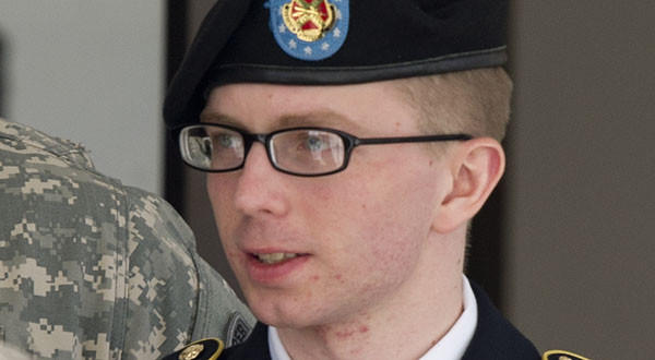Army PFC Bradley Manning is escorted by military police as he departs the courtroom at Fort Meade, Maryland.