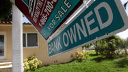 The number of homes mired in the foreclosure process fell again last month, according to a new report, the 15th consecutive month of year-over-year declines.