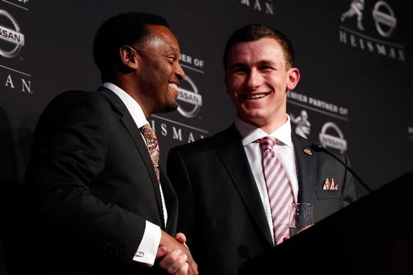 Quarterback Johnny Manziel (R) of the Texas A&M University Aggies and head coach Kevin Sumlin (L) pose after being named the 78th Heisman Memorial Trophy Award winner at a press conference at the Marriott Marquis on December 8, 2012 in New York City. (Photo by Mike Stobe/Getty Images)